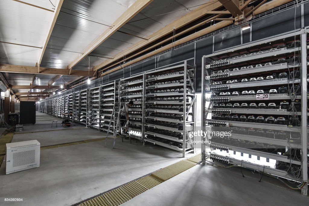 A technician inspects bitcoin mining machines at a mining facility operated by Bitmain Technologies Ltd. in Ordos, Inner Mongolia, China, on Friday, Aug. 11, 2017. Bitmain is one of the leading producers of bitcoin-mining equipment and also runs Antpool, a processing pool that combines individual miners from China and other countries, in addition to operating one of the largest digital currency mines in the world. Photographer: Qilai Shen/Bloomberg via Getty Images