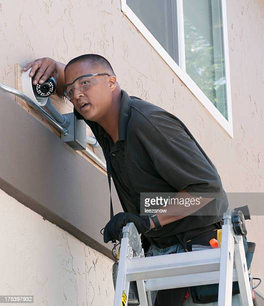 Technician installing security camera