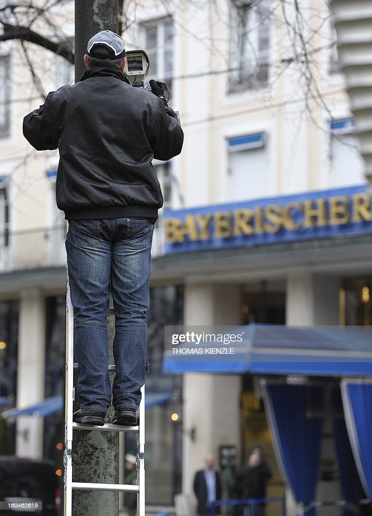 A technician installs a control remote videocamera in front of the Bayerischer Hof hotel in Munich, southern Germany, on February 1, 2013, where the 49th Munich Security Conference will start in the afternoon. The Munich Security Conference is to open with officials, ministers, top military brass and experts from 90 delegations discussing the world's hot button foreign policy issues at the three-day annual get-together. KIENZLE