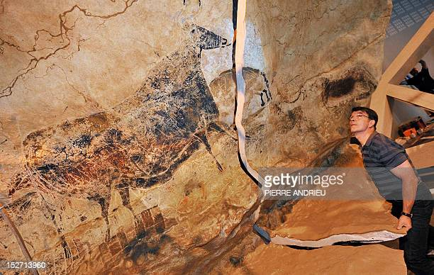 A technician is at work on September 12 2012 in Bordeaux as part of the assembly of Lascaux – International Exhibition a partial facsimile of the...