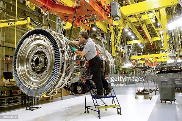 Technician Mike Anderson assembles a General Electric Co GP7200 jet engine for a Boeing 777 at the company's Aviation Assembly Test facility in...