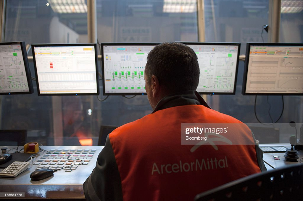A technician monitors computer screens in the control room of the hot steel shop at the ArcelorMittal Poland SA steel mill in Krakow, Poland, on Tuesday, Aug. 6, 2013. ArcelorMittal, the biggest steelmaker globally and in Poland, said on March 15 it expects European demand to slide before rebounding in 2014. Photographer: Will Boase/Bloomberg via Getty Images