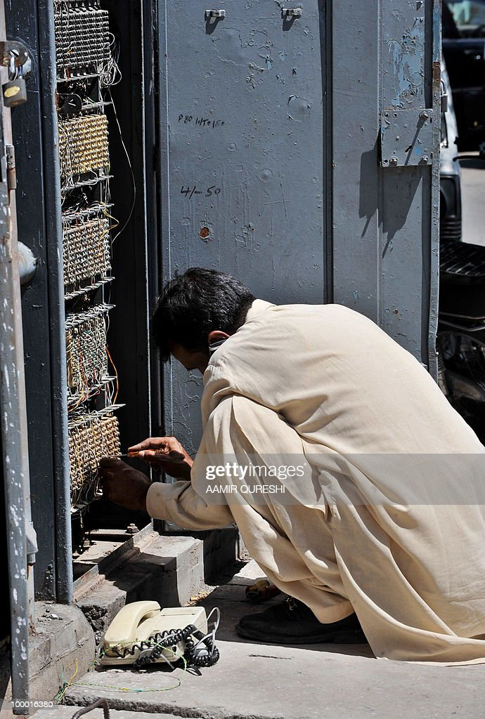 A technician of Pakistan Telecommunication Company (PTCL) repairs a telephone line at a distribution box in Islamabad on May 20, 2010. Emirates Telecommunications Corp plans to purchase another 25 percent in Pakistan Telecom, according to officials. Emirates Telecommunications, the state-owned telephone provider in the United Arab Emirates, won management control of Pakistan Telecom in 2006 after it bought a 26 percent stake in the company for 2.6 billion USD.