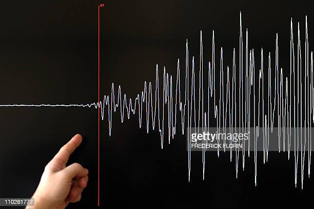 A technician of the French National Seism Survey Institute presents a graph on March 11 2011 in Strasbourg Eastern France registered today during a...