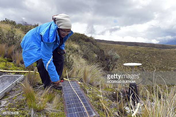 A technician of the Geophysical Institute of Ecuador installs monitoring equipment in Cotopaxi province Ecuador on October 29 2015 AFP PHOTO/Rodrigo...