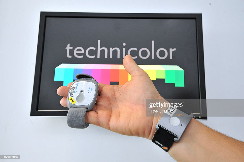 A technician presents a bracelet harnessed with physiological captors capable of registering emotions during the press conference inaugurating the new Technicolor research and development centre in Cesson-Sevigne near the central western city of Rennes on November 22, 2012.