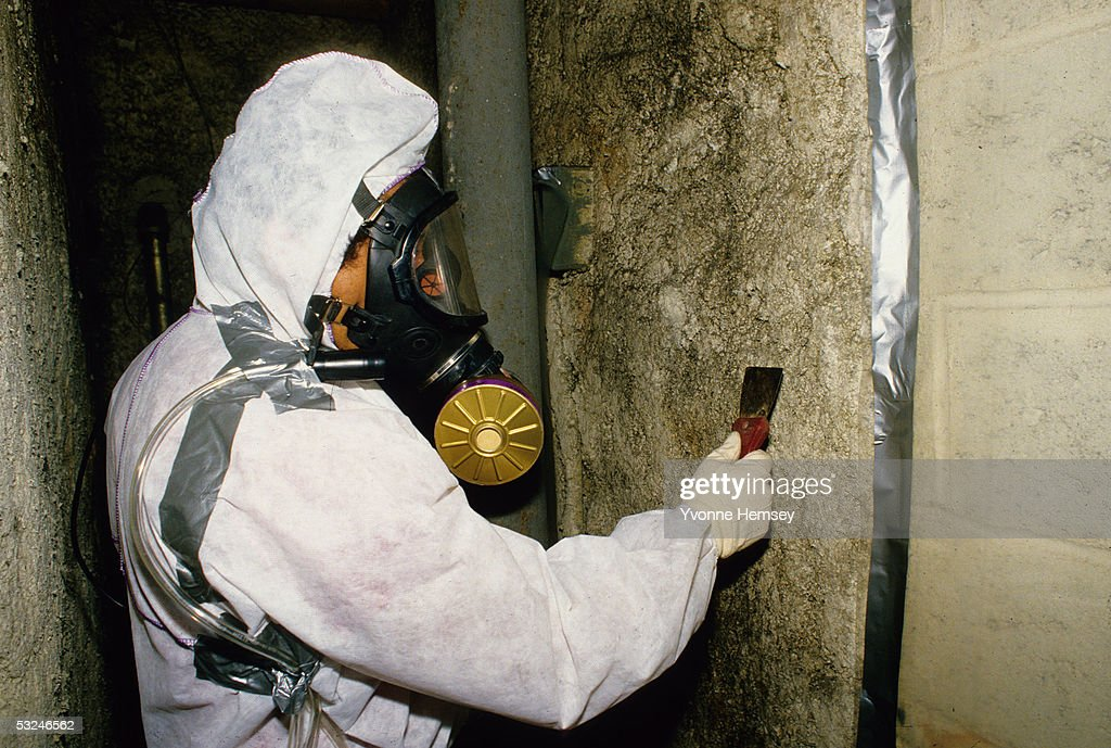 A technician removes asbestos April 1 1995 from apartment building in New York City
