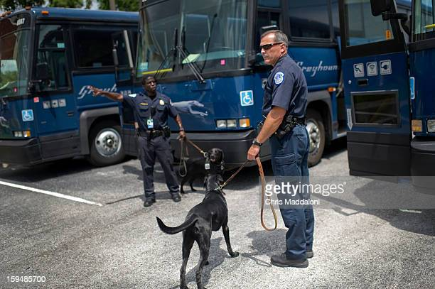 Technician Shawn Haynes work with his fellow tech Irving Washington and his Vapor Wake dog Bessie to sweep buses for the Republican National...