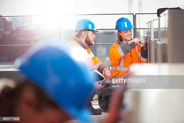 Technician supervisor is advising his trainees