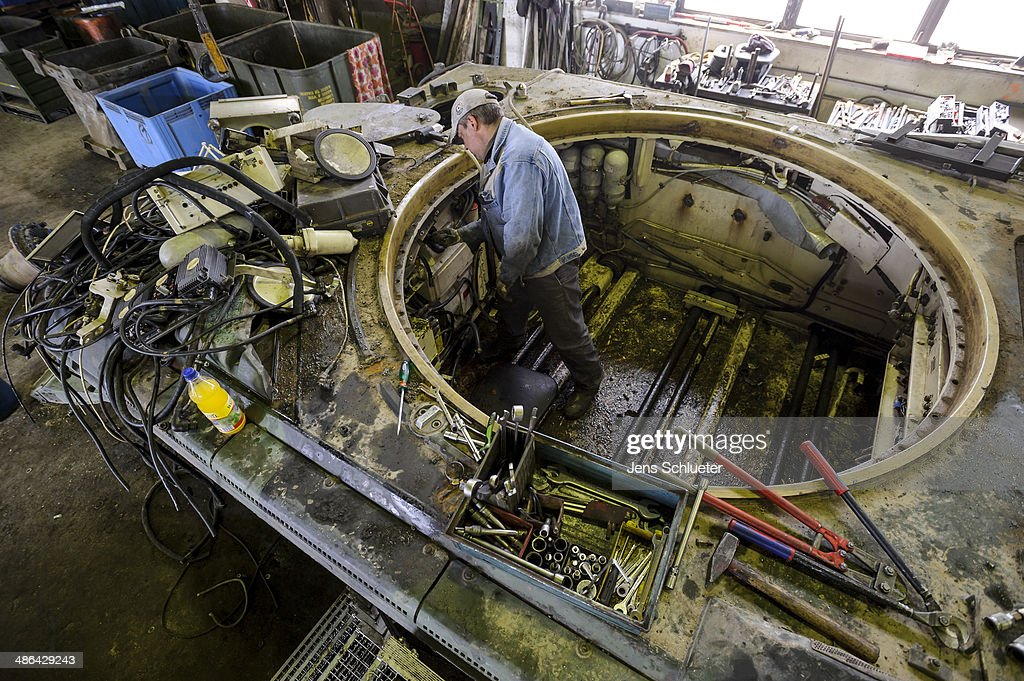 A technician uses a tool to cut parts off a Gepard antiaircraft cannon tank that once belonged to the Bundeswehr at the Battle Tank Dismantling GmbH Koch on April 23, 2014 in Edeleben, Germany. Since the early 1990s the company has dismantled over 15,000 tanks and other armoured vehicles, from German, Austrian, French and other European arsenals, as many nations reduce their military forces in accordance with the Conventional Armed Forces in Europe Treaty.