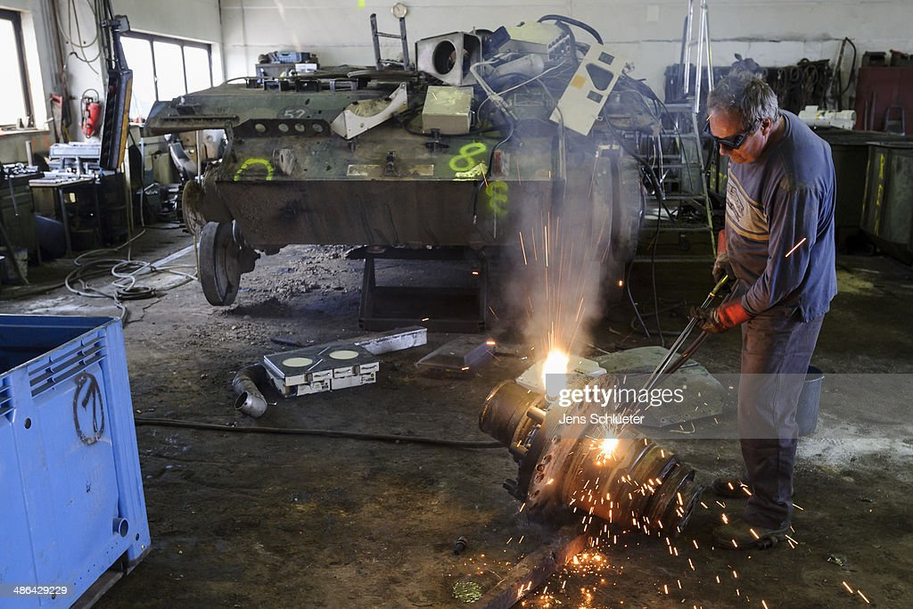 A technician uses a welder's torch to cut parts off a Gepard antiaircraft cannon tank that once belonged to the Bundeswehr at the Battle Tank Dismantling GmbH Koch on April 23, 2014 in Edeleben, Germany. Since the early 1990s the company has dismantled over 15,000 tanks and other armoured vehicles, from German, Austrian, French and other European arsenals, as many nations reduce their military forces in accordance with the Conventional Armed Forces in Europe Treaty.
