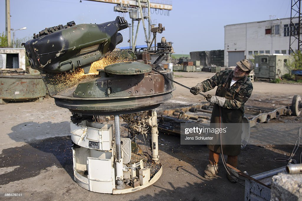 A technician uses a welder's torch to cut parts off a Marder light tank that once belonged to the Bundeswehr at the Battle Tank Dismantling GmbH Koch on April 23, 2014 in Edeleben, Germany. Since the early 1990s the company has dismantled over 15,000 tanks and other armoured vehicles, from German, Austrian, French and other European arsenals, as many nations reduce their military forces in accordance with the Conventional Armed Forces in Europe Treaty.