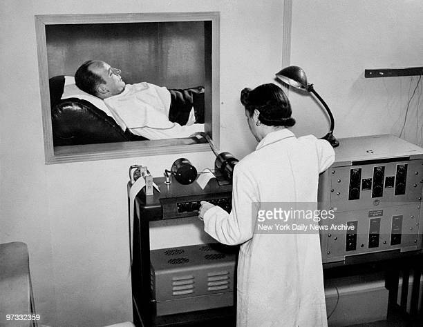 Technician using a electroencephalograph to record the brain waves of a stutterer as part of a research project at National Hospital for Speech...