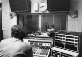 A technician watches from a booth as journalists Janet StreetPorter and Paul Callan present their midmorning show 'Two In The Morning' on the first...