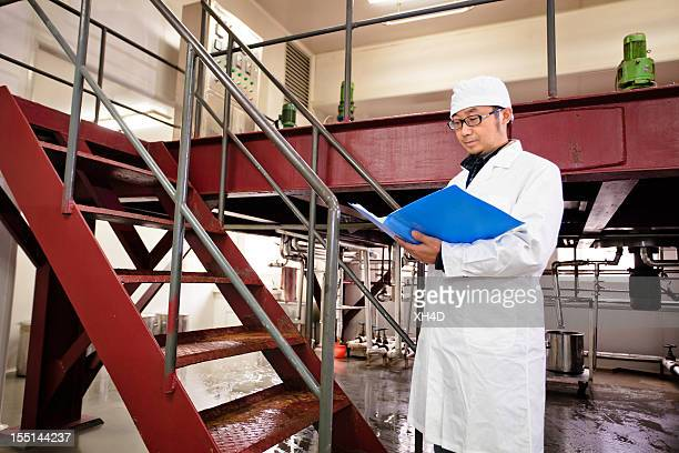 technician working in pharmaceutical factory