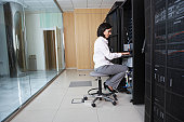 Technician Working in Server Room