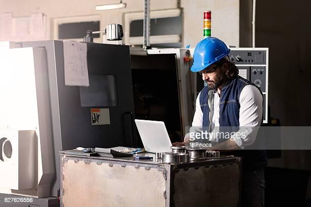 Technician working on machine.