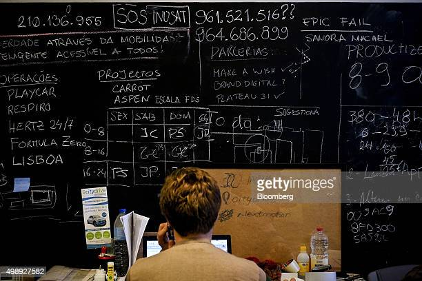 A technician works at his laptop in front of a planning board at the StartUp Lisboa Tech incubator for tech startups in Lisbon Portugal on Thursday...