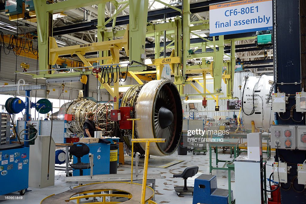 A technician works at the assembly line for jet engines of French aerospace and defence group Safran, manufacturing engines for commercial and military aircraft, on March 18, 2013 at the SNECMA Villaroche site in Moissy-Cramayel, south east of Paris. AFP PHOTO ERIC FEFERBERG