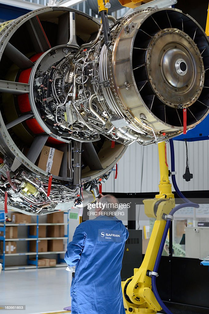 A technician works at the assembly line for jet engines of French aerospace and defence group Safran, manufacturing engines for commercial and military aircraft, on March 18, 2013 at the SNECMA Villaroche site in Moissy-Cramayel, south east of Paris.