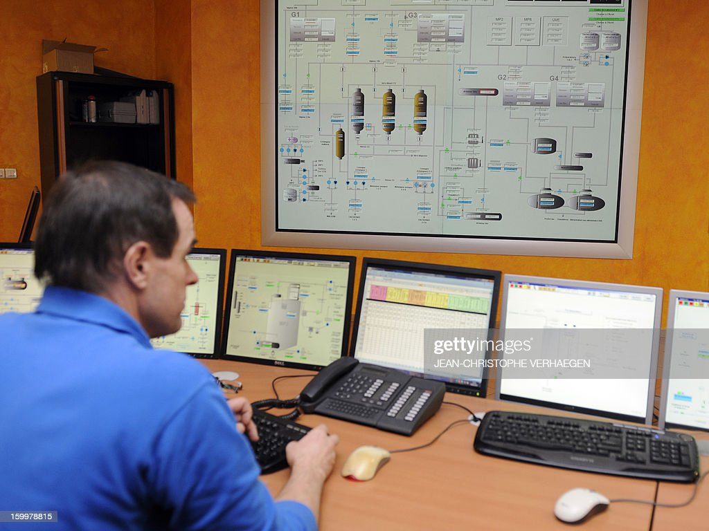 A technician works at the control station at the UEM thermal power plant ('Usine d'Electricité de Metz' in French) in Metz, eastern France, on January 24, 2013. This thermal power plant, coal-fired, gas and biomass, provides electricity and heat to Metz and to the surrounding towns. AFP PHOTO / JEAN-CHRISTOPHE VERHAEGEN