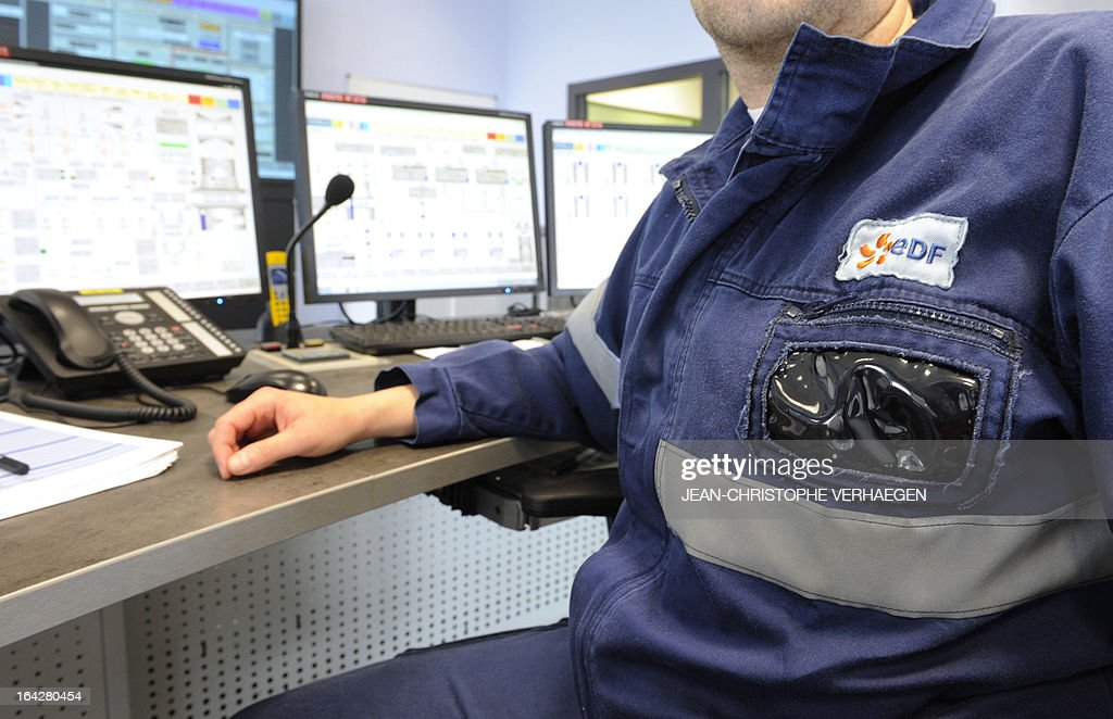 A technician works at the control station on March 21, 2013 at the EDF central gas combined plant, in Blenod-les-Pont-a-Mousson,eastern France. The EDF plant provides electricity with coal-fired in the CPT (thermal production plant) and gas in the CCG (Combined cycle gas).