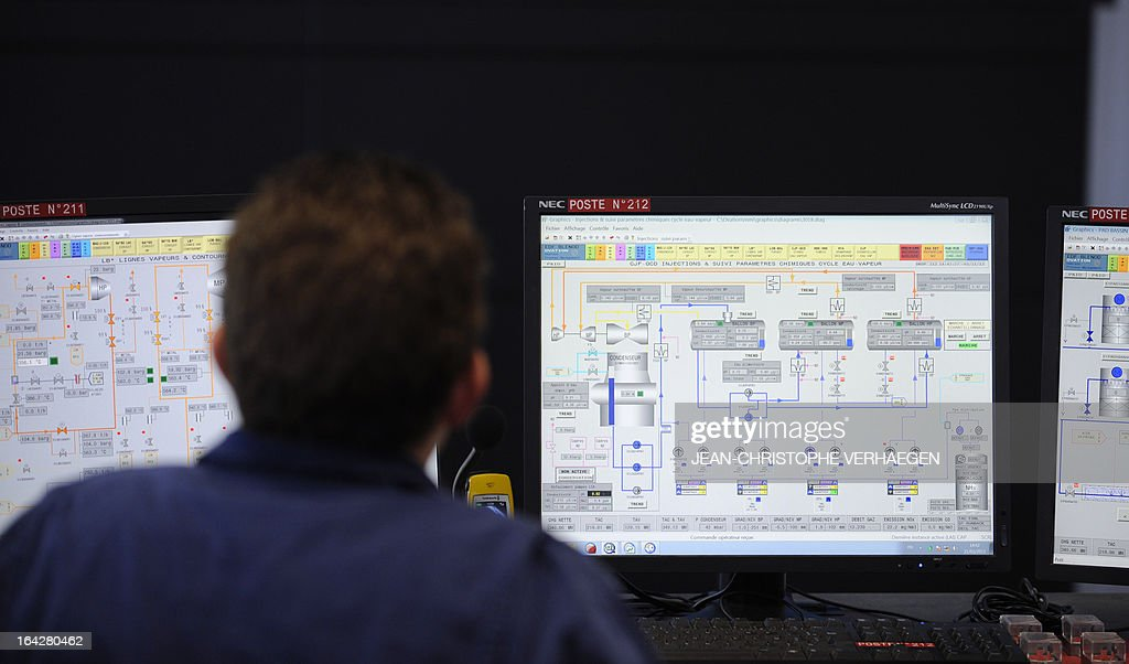 A technician works at the control station on March 21, 2013 at the EDF central gas combined plant, in Blenod-les-Pont-a-Mousson,eastern France. The EDF plant provides electricity with coal-fired in the CPT (thermal production plant) and gas in the CCG (Combined cycle gas). AFP PHOTO / JEAN-CHRISTOPHE VERHAEGEN