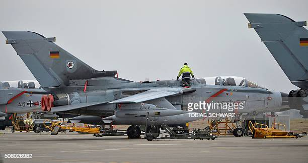 A technician works on a German Tornado jet at the air base in Incirlik Turkey on January 21 2016 / AFP / POOL / TOBIAS SCHWARZ