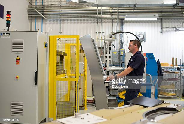 A technician works on a machine that presses helicopter components at the Airbus Helicopters Canada facility in Fort Erie Ontario Canada on Tuesday...
