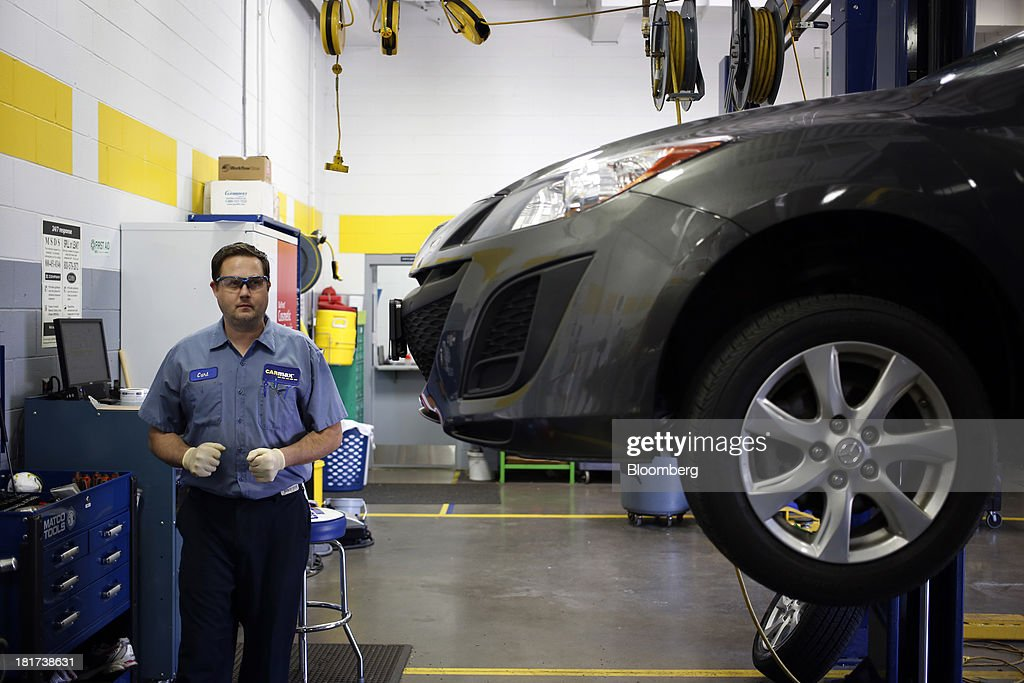 A technician works on a Mazda Motor Corp. vehicle at a CarMax Inc. dealership in Lexington, Kentucky, U.S., on Monday, Sept. 23, 2013. Carmax, which generates 98% of its revenue in the used car market, today reported record second quarter results for the quarter ended Aug. 31. Photographer: Luke Sharrett/Bloomberg via Getty Images