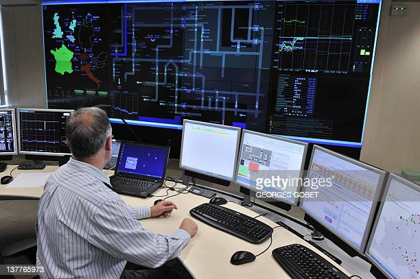 A technician works on December 21 2011 on computer at Coreso an independent company in Brussels Inside an ordinary building in central Brussels a...