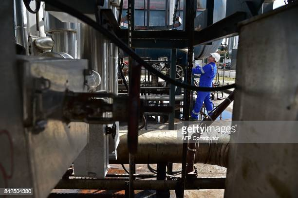 A technician works on oil installations on the premises of the Canadian oil company Vermilion Energy in SaintMery some 50 km southeast of Paris on...