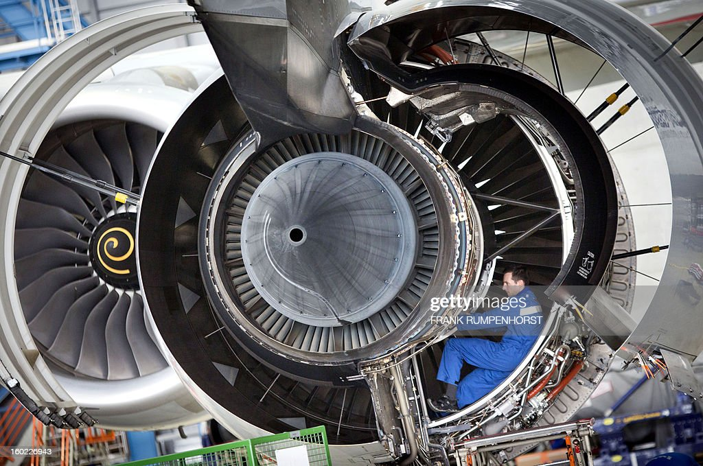 A technician works on the engine of an Airbus A 380 airplane on January 28, 2013 at the maintenance hall of German airline Lufthansa in Frankfurt am Main, western Germany. AFP PHOTO / FRANK RUMPENHORST GERMANY OUT