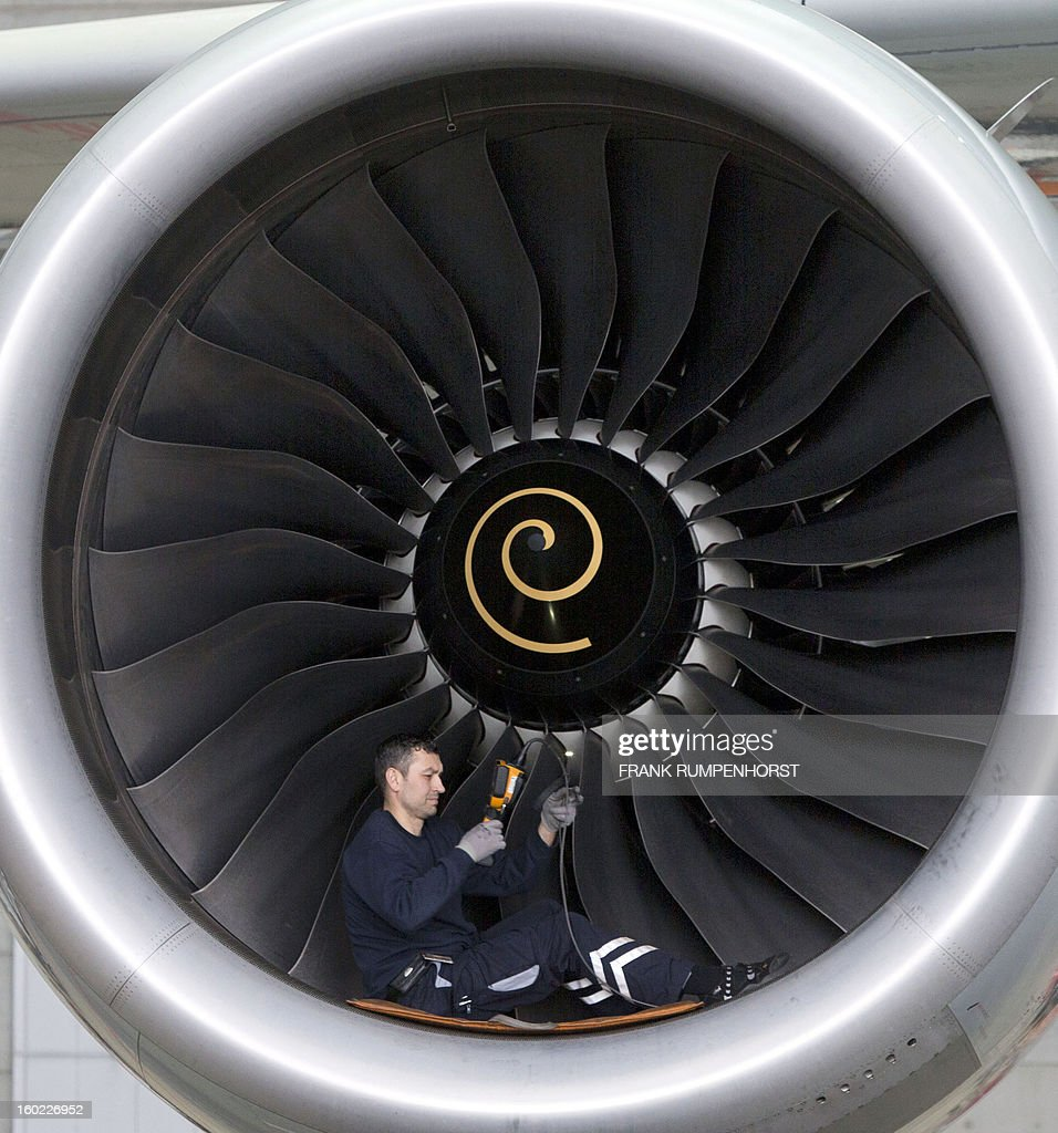 A technician works on the engine of an Airbus A 380 airplane on January 28, 2013 at the maintenance hall of German airline Lufthansa in Frankfurt am Main, western Germany.