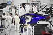 Technicians and engineers work on a 2017 Acura NSX supercar at the Honda Motor Co Acura Performance Manufacturing Center in Marysville Ohio US on...