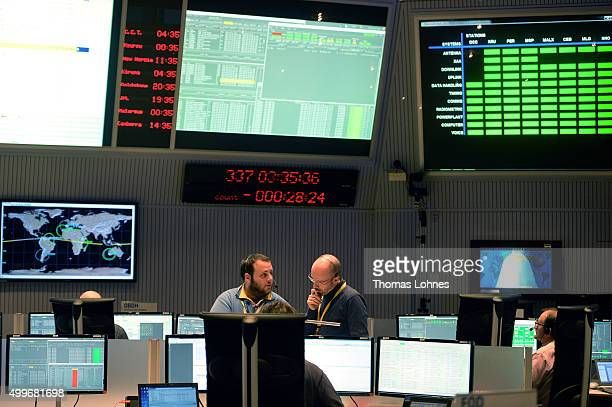 Technicians and flight control operators sit at computers in the control room of the European Space Operations Centre shortly before the launch of...