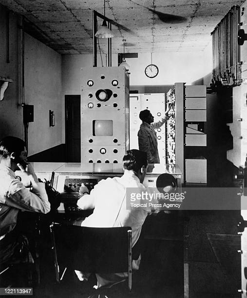 Technicians at work in the Baird Control Room at the BBC's first high definition television station at Alexandra Palace London 23rd August 1936 The...