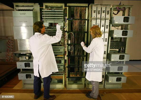 Technicians clean 'ERNIE' the computer which randomly generated winning Premium Bond numbers from 1957 until 1972 at the Science Museum in London on...