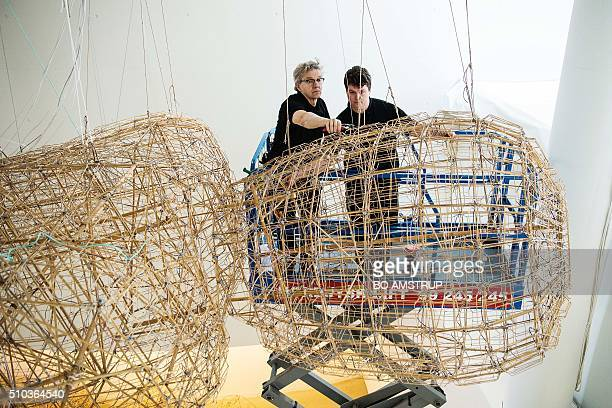 Technicians from the art museum ARoS in Aarhus Denmark remove Chinese artist Ai Weiwei's work Yu Yi from the museum on February 15 2016 Last month...