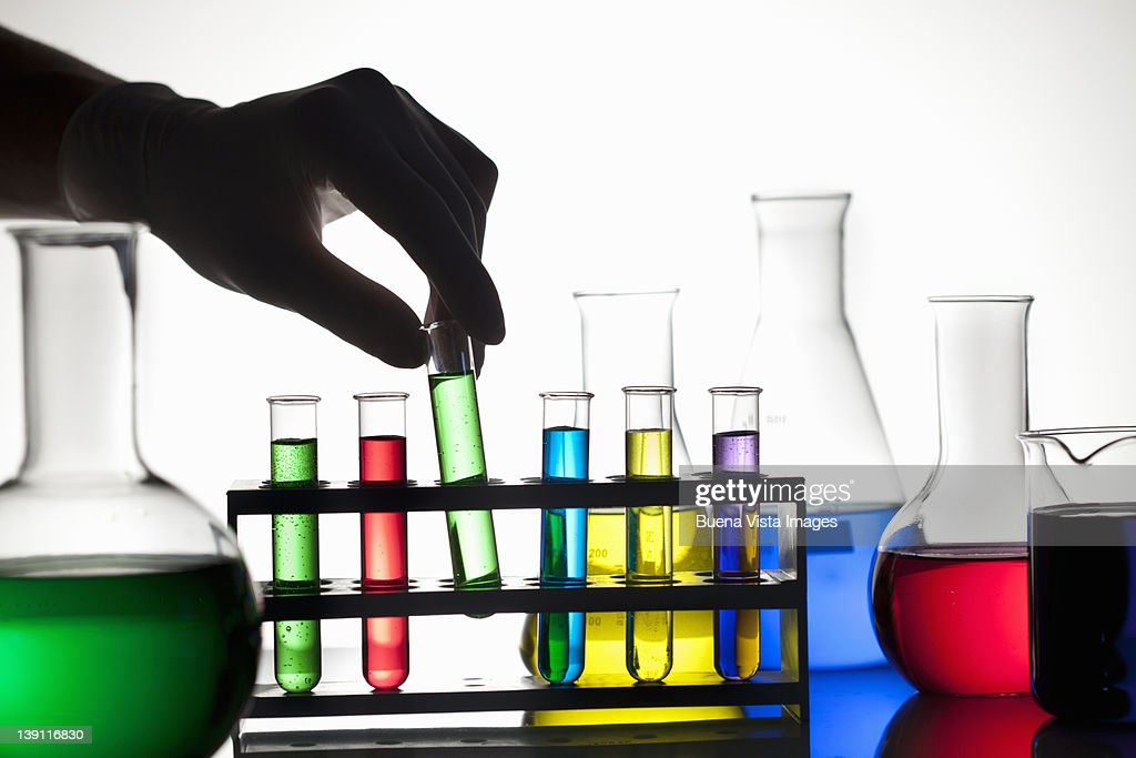 Technician's hand with test tubes : Stock Photo