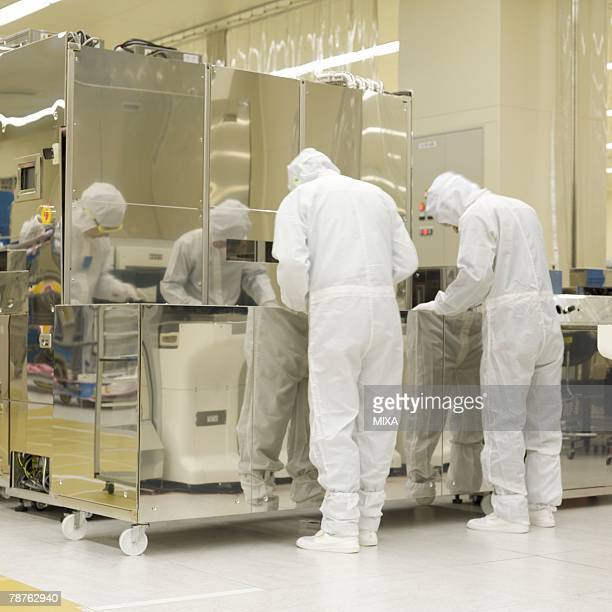 Technicians in white lab suit working in laboratory