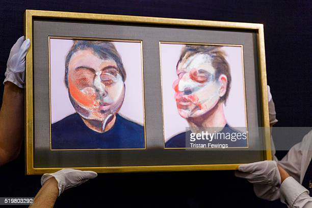 Technicians install Francis Bacon's Two Studies for a SelfPortrait at Sotheby's on April 8 2016 in London England The work will be sold as part of...