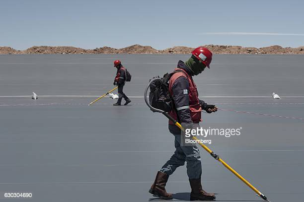 Technicians performs tests on the geomembrane liner at the new industrial pools inside the Salar de Uyuni in Potosi Bolivia on Saturday Dec 10 2016...