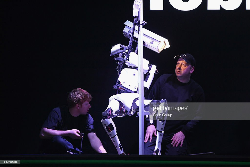 Technicians prepare a poll-dancing robot at the Tobit Software stand the day before the CeBIT 2012 technology trade fair officially opens to the public on March 5, 2012 in Hanover, Germany. CeBIT 2012, the world's largest information technology trade fair, will run from March 6-10, and advances in cloud computing are a major feature this year.