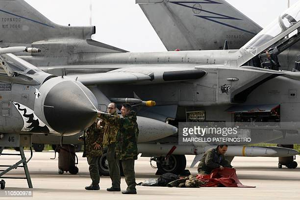 Technicians prepare a Tornado jet fighter of the Italian airforce on March 21 2011 at TrapaniBirgi airbase in Sicily Western and Arab warplanes are...