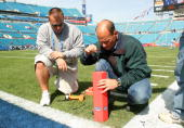 Technicians set up the pylon end zone camera before the start of Super Bowl XXXIX between the New England Patriots and the Philadelphia Eagles on...