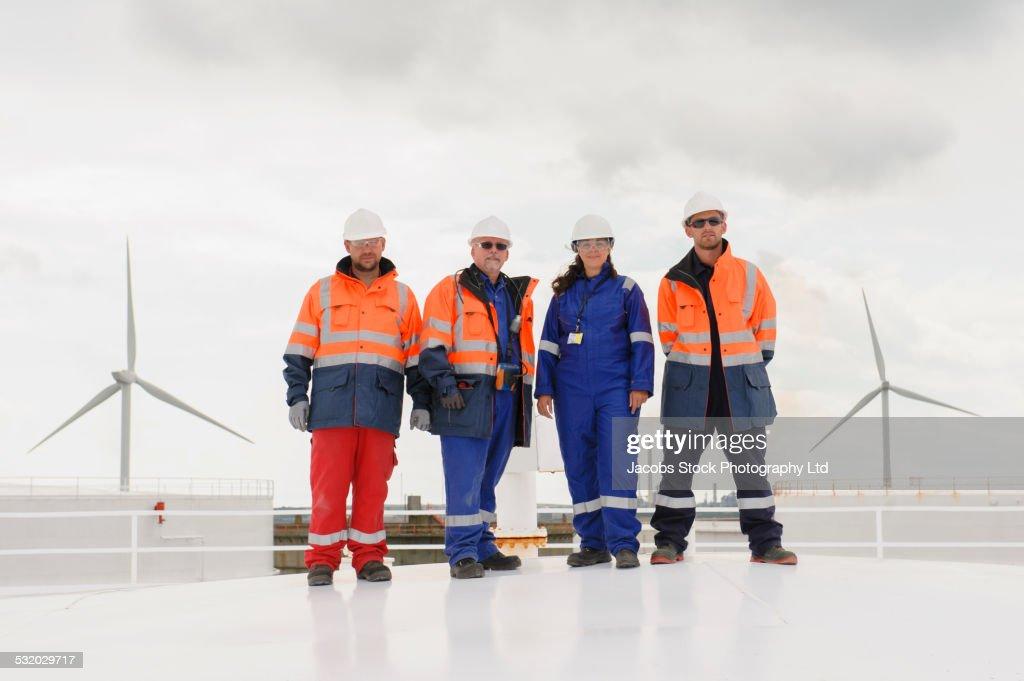Technicians standing on fuel storage tank