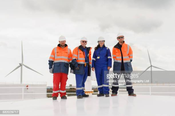 Technicians standing on fuel storage tank