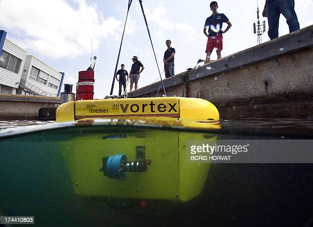 Technicians submerge the new submarine robot 'Vortex' on July 25 2013 in La SeynesurMer southern France The French designed robot is part of the...