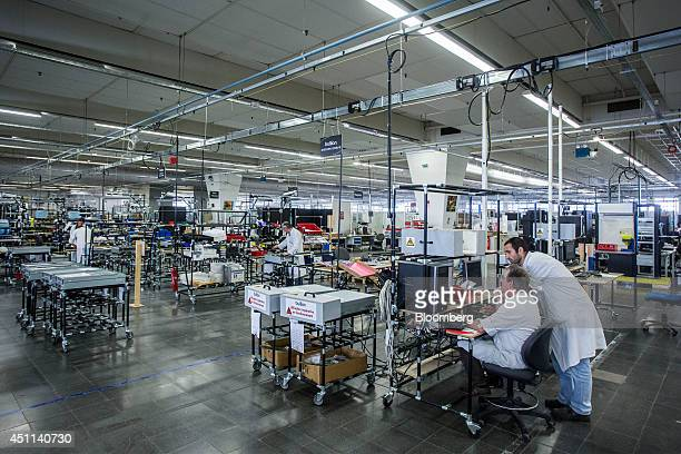 Technicians test server units during assembly of computer systems at the Bull SA headquarters in Angers France on Monday June 23 2014 Thierry Breton...